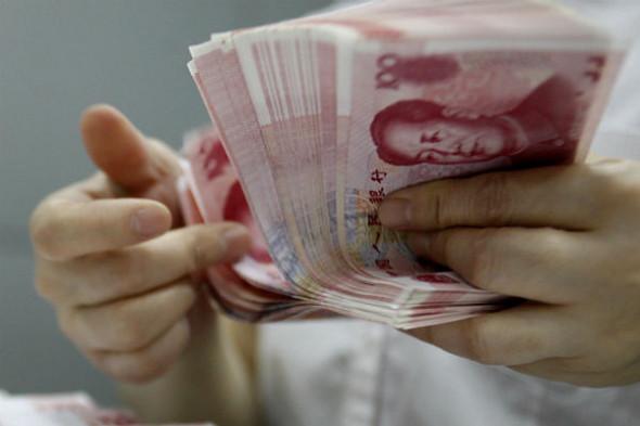 Китай снова девальвирует юань